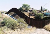 The border fence near Nogales is very expensive to construct, due to the uneven and hilly terrain. The current manifestation of the border fence in this area was put in place in 2011 and is between 18 to 20 feet tall. (Photo by Arturo Montoya)