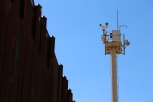 A Border Patrol camera tower oversees the border fence near Nogales, Ariz., and collects video footage 24 hours a day. (Photo by Kyle Wasson)