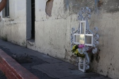 This memorial on Calle Internacional, in Nogales, Sonora, marks the spot where Jose Antonio Elena Rodriguez was shot in October 2012. The 16-year old was in Mexico and a Border Patrol agent (or agents) shot him through the fence. The identity of the shooter is still unknown to the public. (Photo by Kyle Wasson)