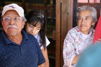 Jose, his wife and granddaughter live in a colonia in Nogales, Sonora. In the 1980s, Jose moved to the area from Guanajuato looking for work near the border. Today he owns a shop selling snacks and water. (Photo by Kyle Wasson)