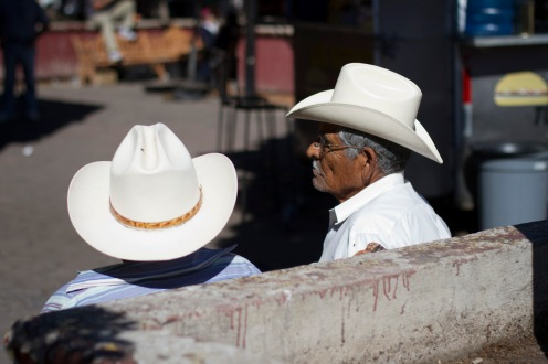 A pair of men rest on a bench in in Nogales, Sonora on Wednesday Nov. 15, 2013.(Photograph by Mariana Dale)